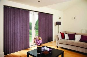 dark purple vertical blinds in a bedroom
