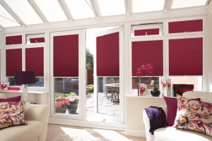 Red blinds in conservatory