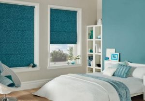 Light blue roman blinds in bedroom