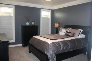 Dark blue themed bedroom