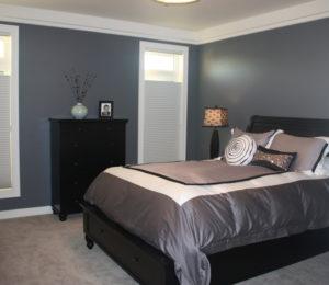 Dark blue themed bedroom