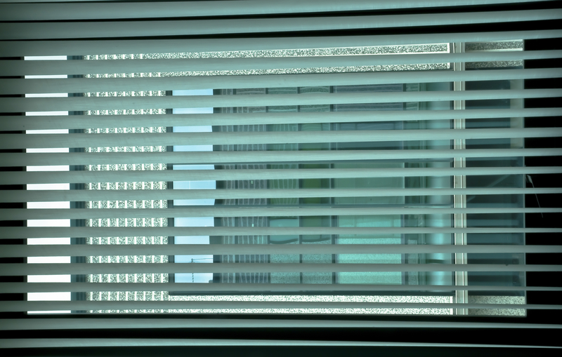 enetian blinds at the office window create an interesting game of colors and colors by drawing a grid on the colored windows of the building opposite